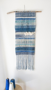 "At the Beach - $265 - Handwoven fibre art wall hanging. It measures 44"" long (including fringe) and 15"" wide. The branch is 25"" wide"