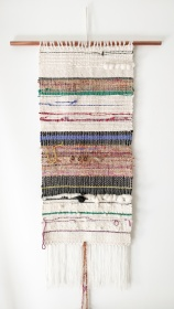 "Licorice - $265 - Handwoven fibre art wall hanging. It measures 57"" long (including fringe) and 15"" wide. The copper pipe is 24"" wide."